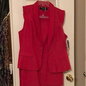 Red Suit with jacket, tie belt and skirt.